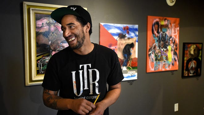 Reno artist Joe C. Rock smiles as he talks about his work that is transforming the Sierra Arts Foundation gallery with his work on Feb. 10, 2106. Rock's work can also be see on Reno buildings around the downtown and midtown area.