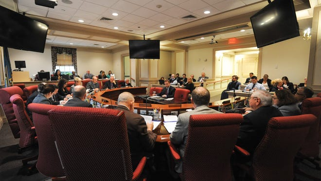 Members of the General Assembly Joint Finance Committee meet in Dover.