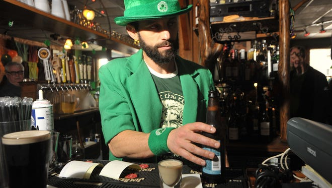 Steve Ouellette on duty behind the bar at the St. Patrick's Day party at Jack of the Wood on Patton Ave. in Downtown Asheville in 2015.
