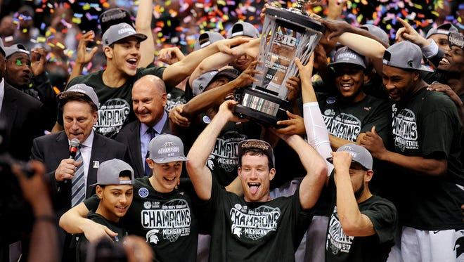 Michigan State senior forward Matt Costello (10) sticks his tongue out as the confetti falls and the team raises the Big Ten Championship trophy after MSU's 66-62 win over Purdue after the Big Ten Tournament Championship game, Sunday, March, 13, 2016 at Bankers Life Fieldhouse in Indianapolis.