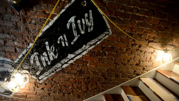 Along the walls of Ink n Ivy, a restaurant and bar