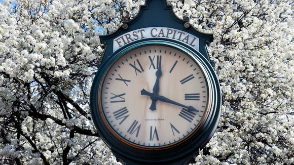 A clock on the corner of Market and Beaver streets is surrounded by flowering pear trees in York.