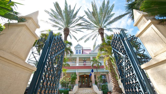 Beyond the gates, guests step into history with charm and style at The Southernmost House in Key West.