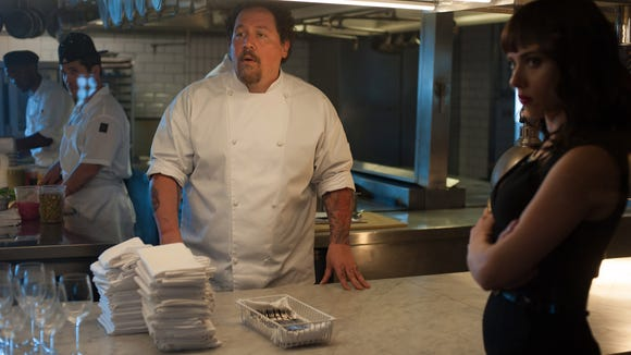 Jon Favreau as Carl Casper, center, and Scarlett Johansson as Molly in a scene from the motion picture 'Chef.'