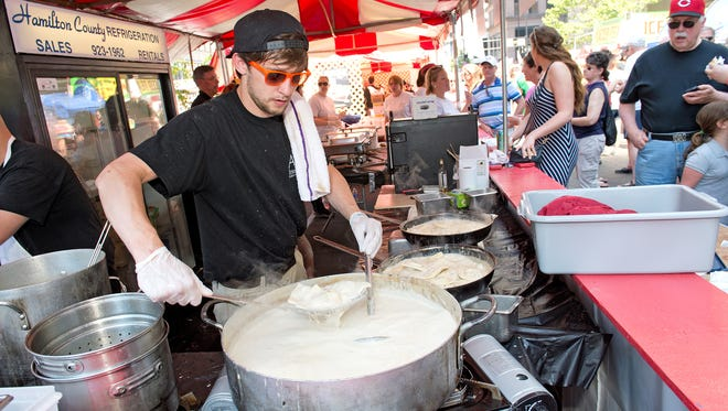 Zac Carpenter of Alfio's tends to the ravioli pot at a part Taste.