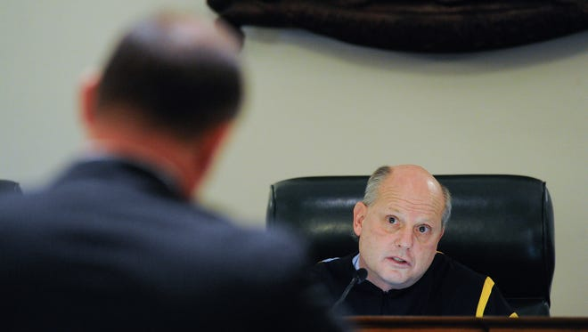 Delaware Supreme Court Chief Justice Leo E. Strine Jr. listens to testimony during a hearing in Dover on March 6.