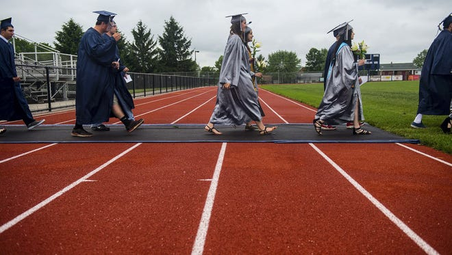 New Oxford students file onto the field as the graduation ceremony begins on June 2, 2015.