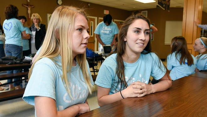 Kaylee Athmann and Miranda Milbauer talk about being members of Ellie's Army during a group gathering Tuesday, May 17, at Cathedral High School.