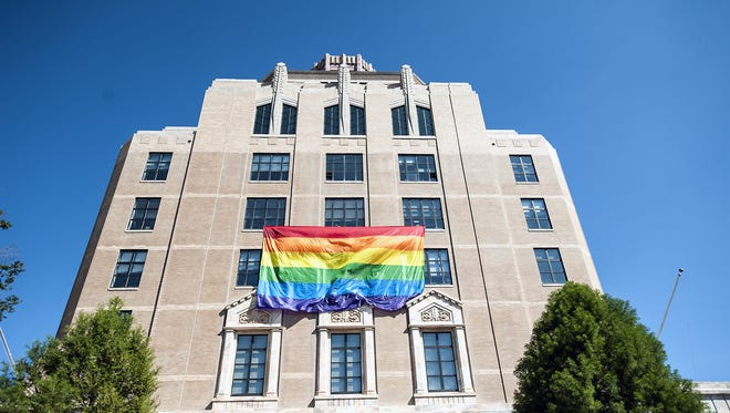 A large rainbow flag hangs from the fourth floor of the Asheville City Building. Buncombe County commissioners are considering a non-discrimination ordinance.