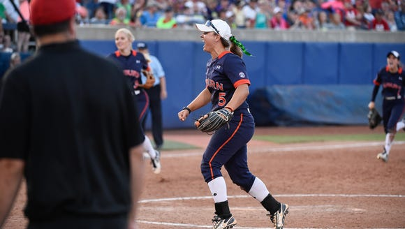 Emily Carosone (5) celebrates Auburn's 4-3 win over