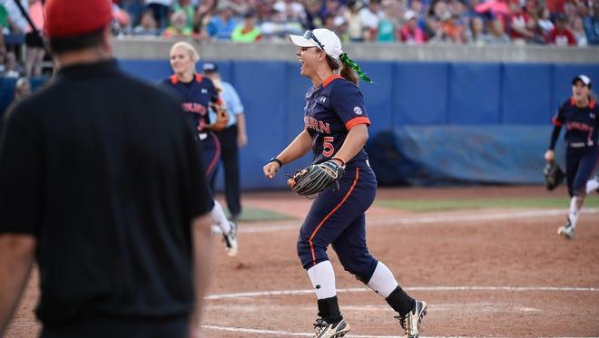 Emily Carosone (5) celebrates Auburn's 4-3 win over Georgia in the Women's College World Series in Oklahoma City.