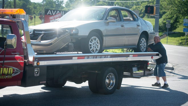 Vehicle is loaded up after a collision with a tractor trailer at Route 30 and Biesecker Road in Jackson Township.
