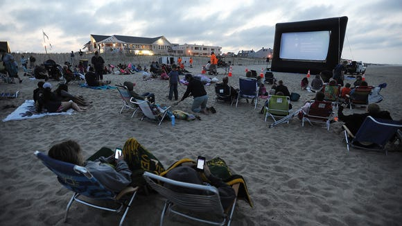 Movie Night on the beach in Bethany Beach is a great date night idea for those looking for fun on a budget.