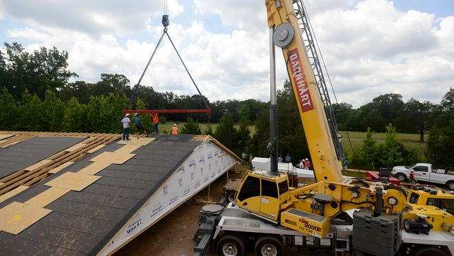 A crane was brought in Thursday to help hoist the roof of Riverview Baptist Church.