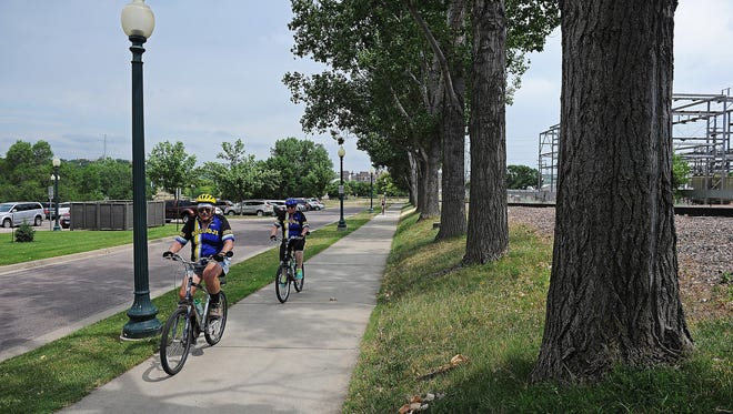 Cyclists ride through Falls Park during Tour Sioux Falls Saturday, June 25, 2016, in Sioux Falls.