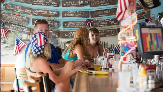 Patrons enjoy lunch at Gary's Dewey Beach Grill in Dewey Beach on Friday. From January to mid-June in 2015, 58,400 rooms had been rented for weekends, according to the Rehoboth Beach-Dewey Beach Chamber of Commerce.