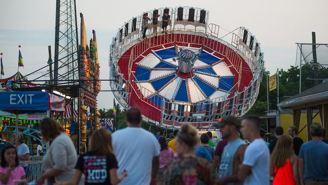 Crowds pack the Pleasant Hill Firefighters Carnival on July 21, 2014.