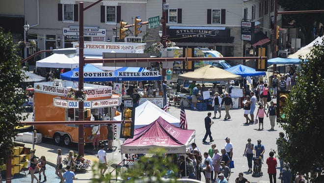 Crowds gather in the square in downtown Hanover for the 31st annual Dutch Festival on Saturday July 26, 2014.