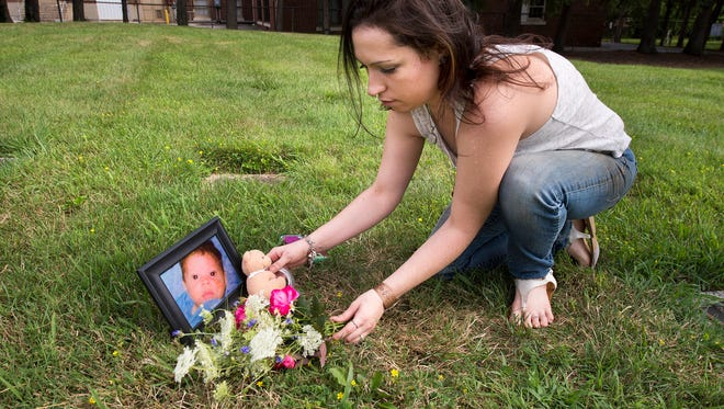 Haley Eisenhart found the grave of baby Xander at Mount Rose Cemetery and marked it with a framed photo, a bouquet of flowers from her West York home and a toy bear that had been passed among her three sons.