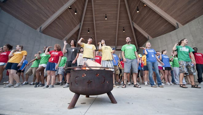 Youth counselors perform a skit as part of the nationwide celebrations of the 125th anniversary of camping at the YMCA in 2010 at Sherman Lake YMCA in Augusta.