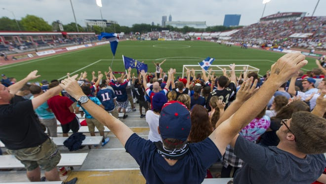 Fans begin to turn on the excitement as kick-off approaches at the start of the game. Indy Eleven hosted New York Cosmos in NASL soccer action at Michael A. Carroll Track & Soccer Stadium in Indianapolis, Saturday, August 30, 2014.