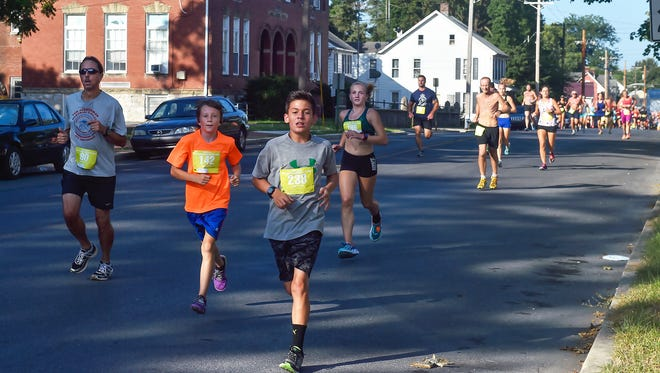 Runners of different age groups compete in the Ausherman race on Saturday, August 13, 2016 in Chambersburg, Pa.