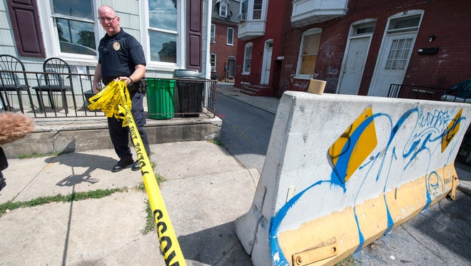 Police roll up police line tape after investigating a shooting at Cleveland Avenue and Lafayette Street in York.