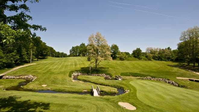 A view of Springbrook's 1st tee and 9th green as seen of the balcony of the Ale House Restaurant.