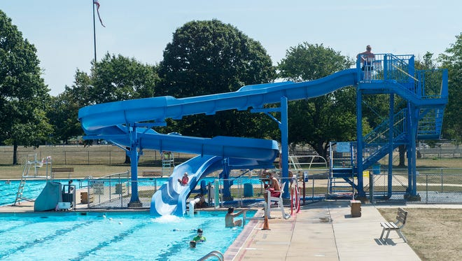 Families swim and enjoy the pool one last time on Monday, Sept. 5, 2016 in Chambersburg, Pa. The pool will be closed until 2018.