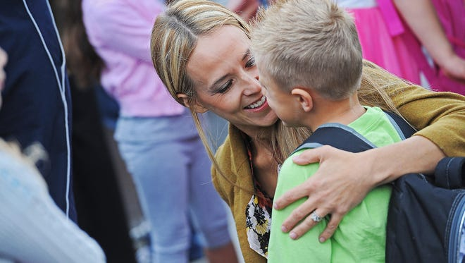 Marci Gassen says goodbye to her son Gavin, 6, on his first day of kindergarten at the new Sonia Sotomayor Elementary School Tuesday, Sept. 6, 2016, in Sioux Falls.