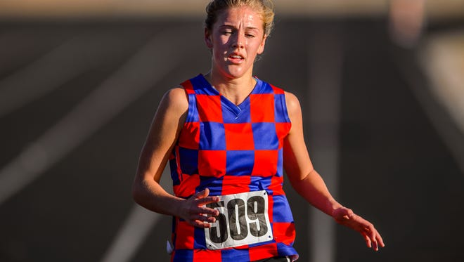Riverside's Cate Ambrose finishes first and leads the Warriors to their fourth straight Greenville County girls cross country championship Saturday at Woodmont High School.