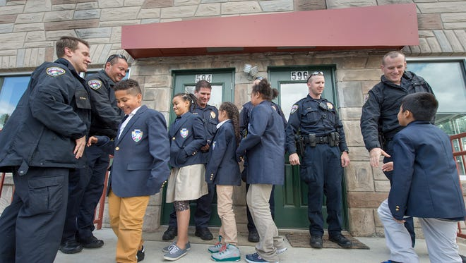 Lincoln Carter School ambassadors welcome York City Police back to an satellite location in the 500 block of West Princess street at the former Gus' Place bar.