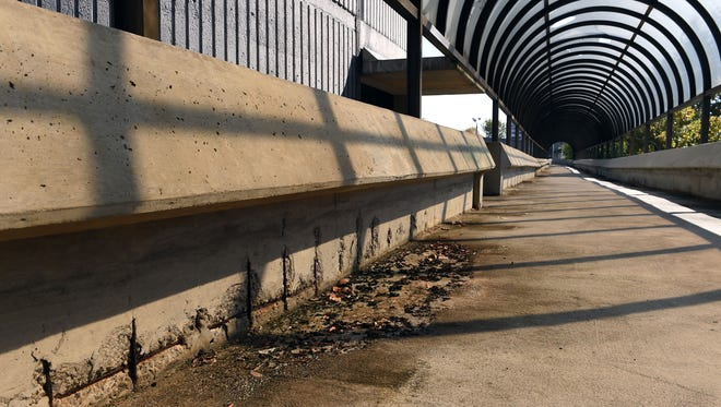 Exposed rebar along the pedestrian walkway at the Knoxville Civic Auditorium and Coliseum parking garage Tuesday Nov. 1, 2016. The city is bidding out work to assess the garage that currently has excessive cracking, exposed and rusted rebar and water seepage.