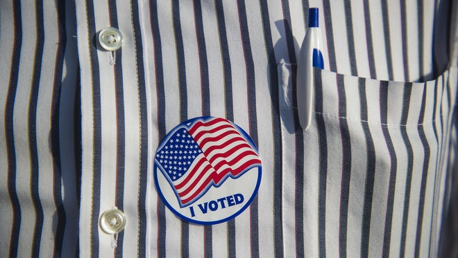 In this file photo, stripes meet stripes on a volunteer's shirt in Straban Township during the Pennsylvania primaries on April 26, 2016.  Clare Becker - The Evening Sun