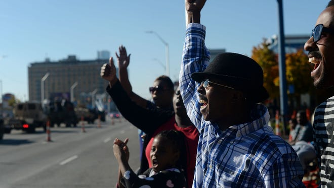 Richard Hall, of Detroit, center, cheers as military vehicles honk their horns during Detroit's Veteran's Day parade on Sunday, Nov. 6, 2016 on E. Jefferson Avenue in Detroit. Rachel Woolf, Special to the Free Press