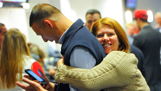 U.S. Rep. Scott Perry gets a hug from York County Republican Committee Vice Chair Allison Blew, of Lower Windsor Township, during the Republican Committee election watch, Tuesday, Nov. 7, 2016. John A. Pavoncello photo