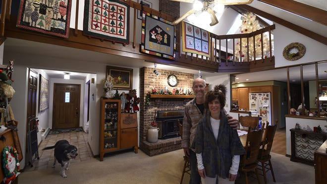 Handmade quilts and Santa Claus dolls created by homeowner Joan Mahoney with husband John at their 1030 Louisiana St. holiday house in Sturgeon Bay. The home features four large decorated Christmas trees among several miniatures for the Holiday Home Tour on Dec. 3 benefiting DOOR CANcer Inc.