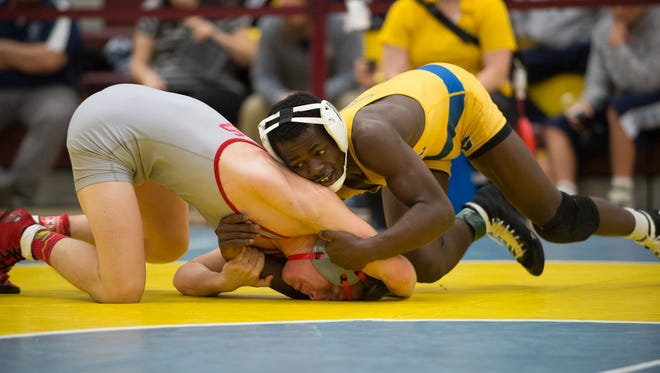 Sussex Central's Rashad Stratton (right) works his way to a 9-3 decision over Smyrna's Cole Sebastianelli in the 126-pound final at the Milford Invitational last Saturday. Both teams will compete in the Beast of the East this weekend.