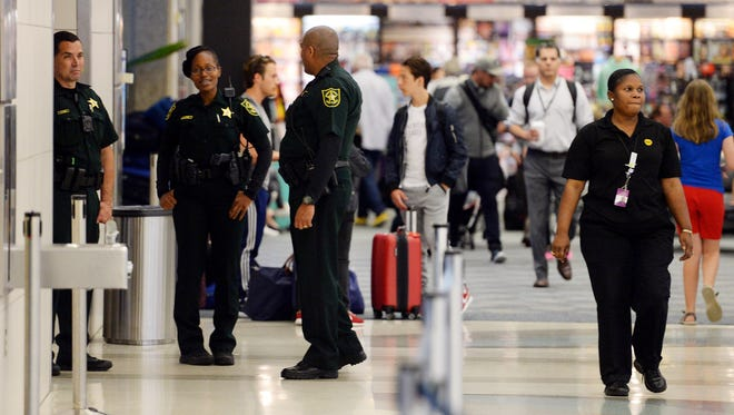 The routine slowly gets back to normal at Fort Lauderdale-Hollywood International Airport just a day after a shooting rampage on Jan. 7, 2016.