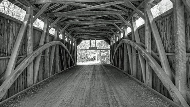 Interior of covered bridge with Burr arch truss.