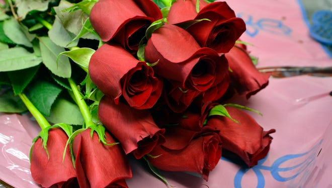 Employees at Royer's Flowers & Gifts, 2555 Eastern Blvd., are hard at work putting together some of the more then 400 dozen rose bouquets in preparation for Valentines Day, Thursday, Feb. 8, 2017. John A. Pavoncello photo