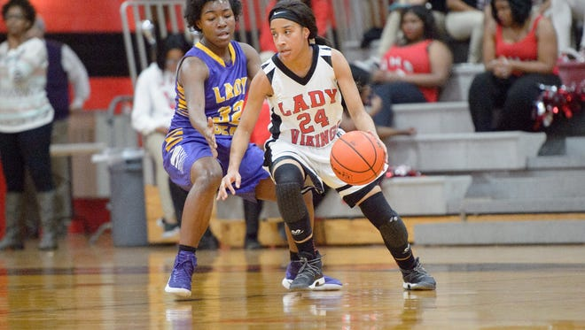 Northside's Harmony Chavis drives to the basket during the Lady Vikings' regional win over St. Martinville.