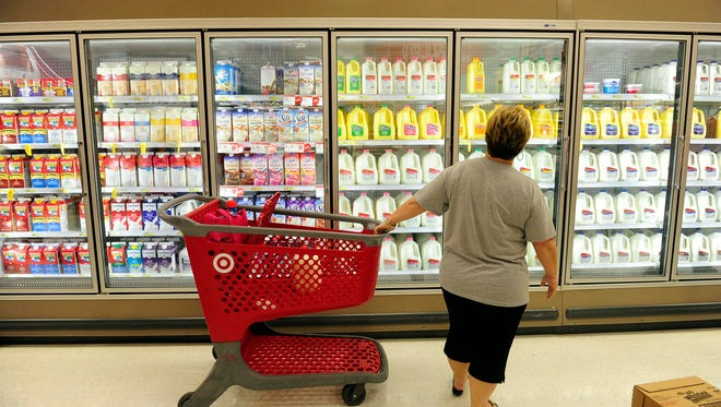 A shopper ponders the dairy case at a Target store