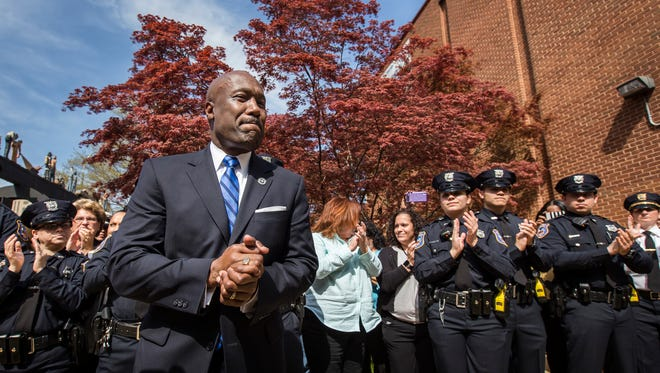 Former Wilmington Police Department Chief Bobby Cummings receives a standing ovation from those in attendance during a walkout ceremony outside the department in Wilmington on Thursday afternoon.