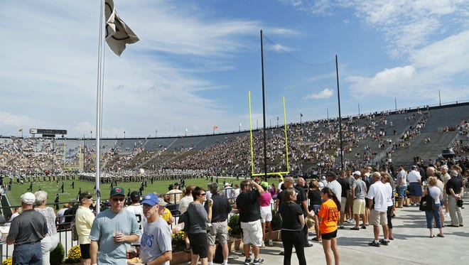 """Fans watch from the newly redesigned south end zone as the Purdue """"All-American"""" Marching Band takes the field prior to the Boilermakers game against Western Michigan Saturday, August 30, 2014, at Ross-Ade Stadium."""