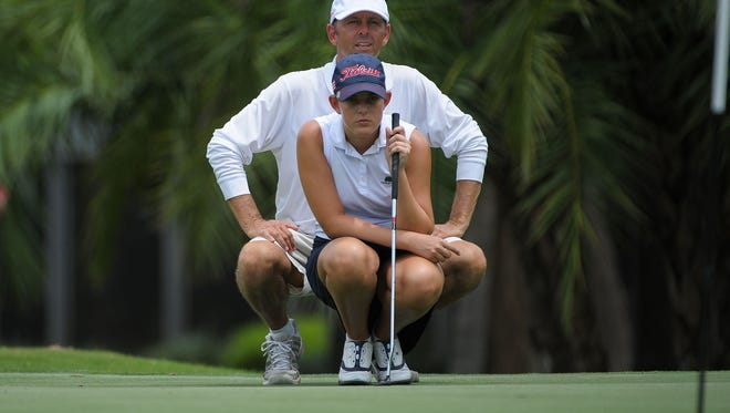 Emma Bradley of Naples looks over her putt with caddie and father Andy during the U.S. Women's Open sectional qualifier at Bradenton Country Club in 2017. Bradley will be playing in the Florida State Women's Open at Quail Creek in Naples beginning Friday.