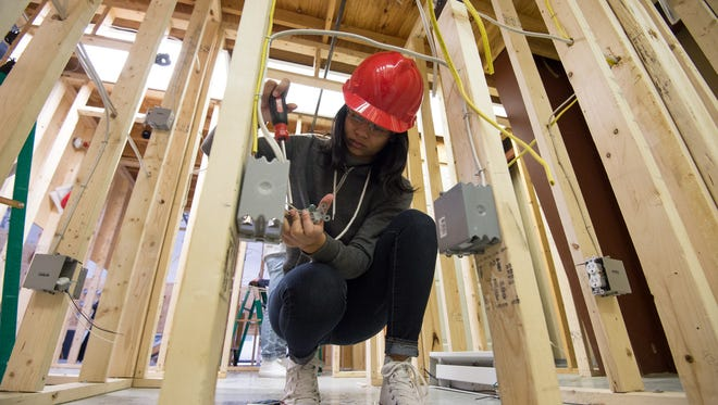 Paula Scott Jones, a sophomore at Polytech High School, works on wiring in her electrical construction class.