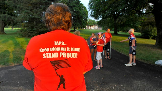 Neighbors and supporters gather in front of Josh Corney's Glen Rock home for the playing of Taps, Tuesday July 4, 2017.  John A. Pavoncello photo
