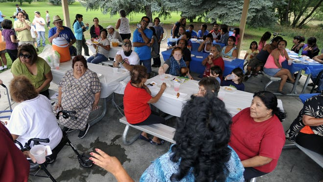 Residents of the Buckingham neighborhood gathered for a Neighborhood Night Out celebration in 2013. The annual national event, which is aimed at helping neighbors gather and get to know each other, is scheduled Aug. 1.