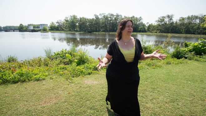 Carol Johnson-Krumm of Milford next to the Nanticoke River in Seaford where her son Justin Johnson ran from the police in handcuffs and jumped into the river where he drowned after yelling for help.